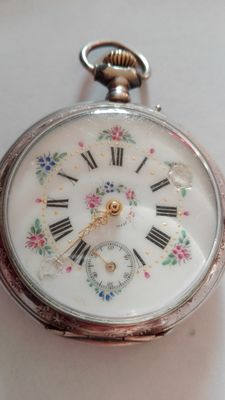 Men's pocket watch from the 1920s with finely inlaid mechanism