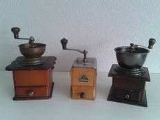 Three beautiful classic coffee grinders.