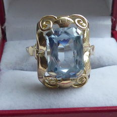 Silver ring with light blue topaz in Jugendstil style.