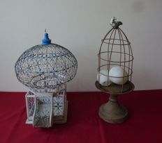 Old vintage decorative bird cage in metal and wood & decorative cage on iron pedestal with dove on top.