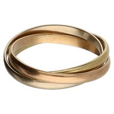 Three tri-colour stack rings, 18 kt gold - 17.5 mm