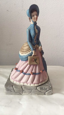 Lovely porcelain sculpture for Avon of Florence Albee