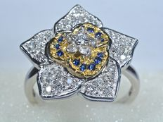 Gold (18 kt) ring with  multiple diamonds, 0.50 ct, and blue sapphires.
