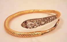 18 karat gold bracelet set with rose diamond (approx. 1.40 ct) and ruby Weight 50.2 grams.