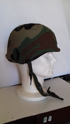 American kevlar helmet mod. PASGT (Personnel Armour System for Ground Troops) including camouflage woodland drape