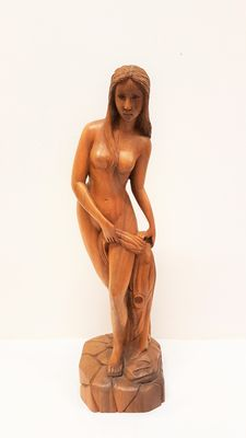 Large wooden sculpture of a naked woman