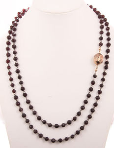 Garnet necklace, long model with a gold spherical clasp