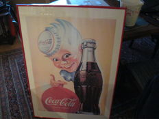 Two old Coca cola posters in frame