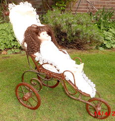 Vintage Biedermeier dolls tricycle made from wrought iron, rattan and wood with brocade cover and lace trim