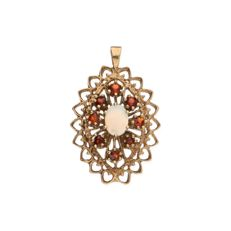 Yellow gold ajour pendant set with an opal stone and 8 orange garnet stones