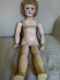 Vintage doll with porcelain head 65 cm