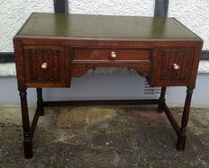 Leather inlaid carved desk, mid 20th century