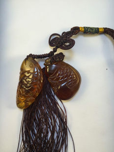 Burma amber carved fish ornaments,  hand woven China knot, weighs 10.9 grams.