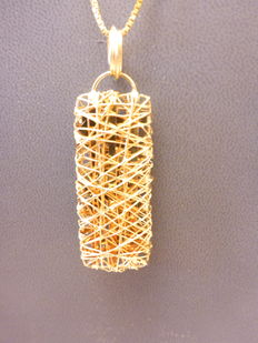 Gold necklace with modern pendant