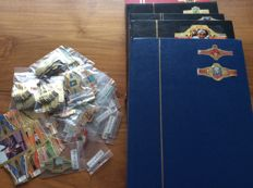 Extensive collection of cigar bands in 5 sets and 1 case with series sorted in bags.