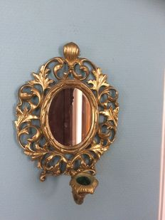 A 1-armed wall candle holder made of brass with mirror in rococo style, 20th century