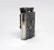 Petrol lighter in chromed metal with wrought imperial shield - first half of the 20th century