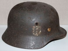 German relic Helmet M35 with remainders of liner and chin strap-WW2