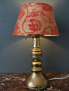 Classic brass table lamp with red/gold velvet shade.