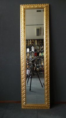 Exceptionally large full length mirror with facet cut glass - hand gilded frame with ornaments - gold.