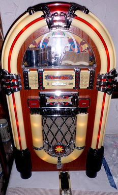 "Retro jukebox, ""Elta"" brand, 2752 with western-style radio, tape deck, CD player, and remote control"