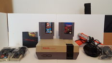 Nintendo Nes with 4 games, 2 Joypads and the nes zapper/gun