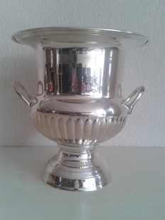 Silver plated champagne cooler on lower base, with two handles, England.