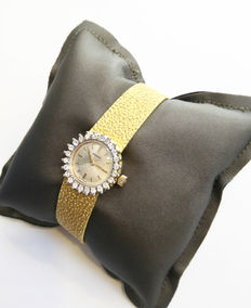 Vintage gold watch with diamonds