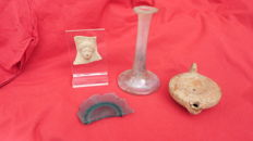 Objects of ancient Rome: a terracotta face (ancient Greece) / an oil lamp / a lacrymal vase made of iridescent glass  / a piece of blue glass (4)