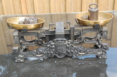 Beautiful cast iron scale with brass trays and six weights