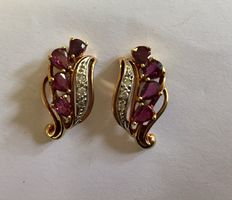 A pair of gold ear studs set with ruby and diamond.