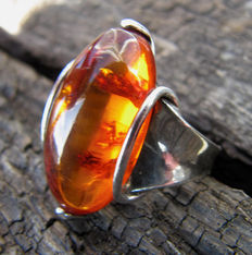 Old Art Deco 835 silver ring with a smooth oval amber stone