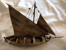 Vintage fisherman boat in bronze