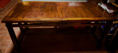 Rectangular and extensible dining table, made of Tabasco mahogany wood, France, end of the 20th century.