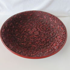 Large, finely carved lacquered dish - China - 1st half 20th century.