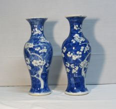 Porcelain pair of vases, with a blue and white prunnus decoration - China - ca 1900