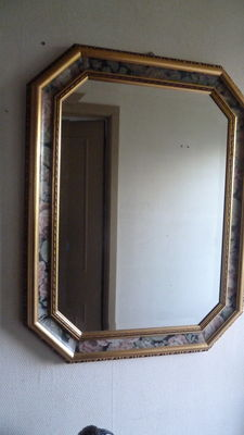 Large gilded mirror with painted flower border