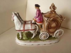 Porcelain carriage with couple