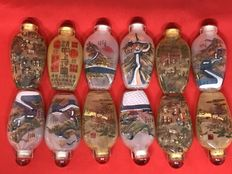 Large lot of 12 hand-decorated glass snuff bottles