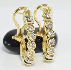 0.85 ct diamond earrings in 14 kt gold