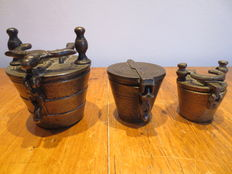Three bronze nest of weights, first half 20th century