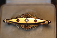 Antique English gold brooch with diamond and ruby, 19th century.