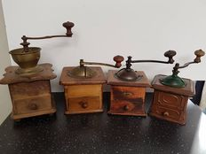 Four large antique hand coffee grinders including 1 metal - Netherlands - 1930/40