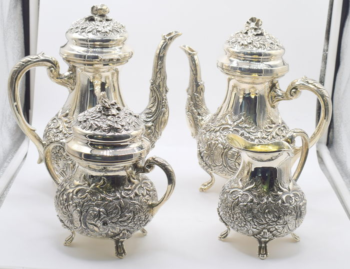 Sterling silver highly decorated  tea set , international hallmarked 900