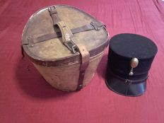 Cap for the Dutch Marechaussee (Holland) with original travel hat box made of leather with image from Algerian Bazaar merchant to 1890