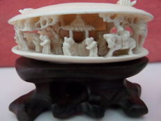 Ivory sculpture depicting a shell with characters, China