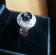 SIlver ring with purplish blue spinel