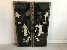 Two Chinese lacquer panels decorated with mother of pearl with a decor – China – 2nd half of the 20th century