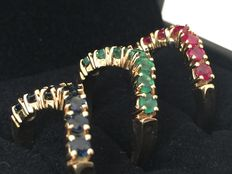 Set of three 18 kt gold rings with emeralds, sapphires and rubies