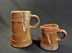 Stoneware brandy cups showing some imperfections caused during the baking process - H125 and 80 mm